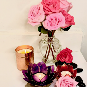 Self Care, relaxing candles and flowers for good energy