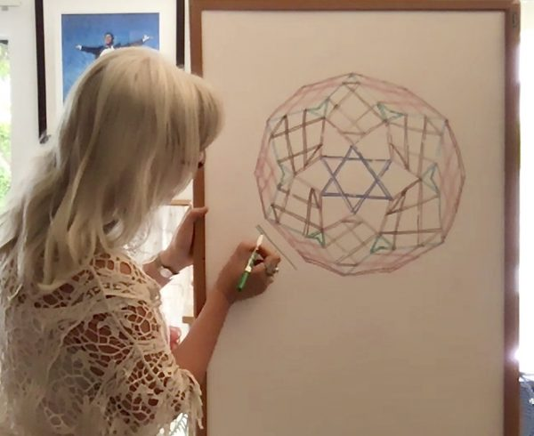 learing how to draw the diamond yantra in a webinar